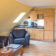 Wohnraum mit Küchenzeile Wohnung 6